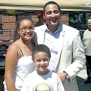 Rodríguez, seen here with local youths, is expected to continue to serve Assembly District 68.