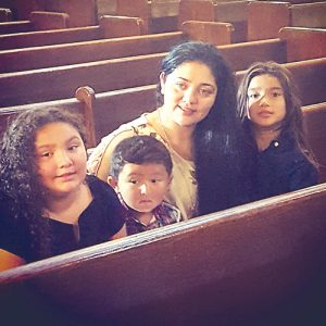 Morales-Guerra with her three children.