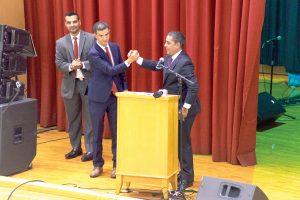 Congressman Adriano Espaillat salutes the Councilmember.