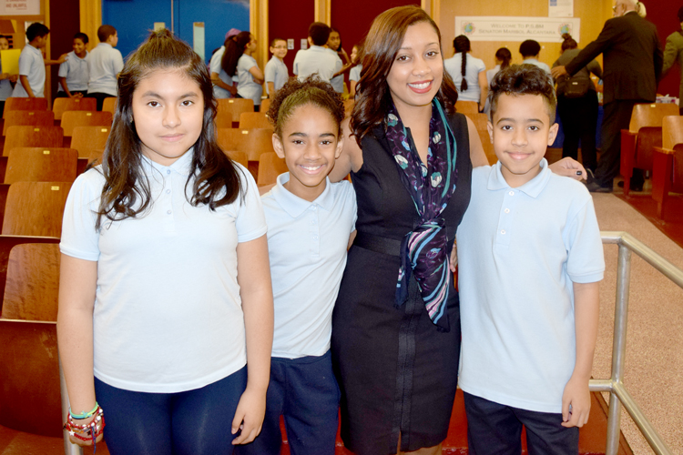 """""""It's really helped the kids,"""" said Coordinator Denise Cruz, here with students."""