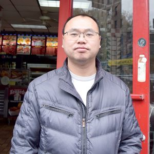 """We're just waiting,"" said Danny Lin, owner of New York Liquors, on Monday. Photo: G. McQueen"