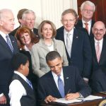 President Barack Obama signs ACA into law on March 23, 2010.