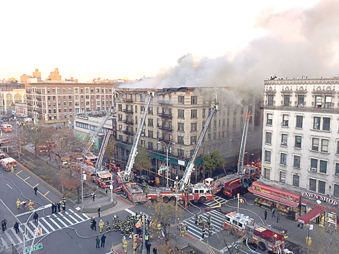 The massive fire ripped through the building.