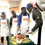 The players carve up the bird. Photo: Food Bank NYC