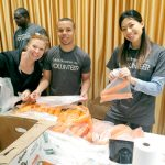 Volunteers from Moet Hennessy helped pack produce in early November. Photo: Food Bank NYC