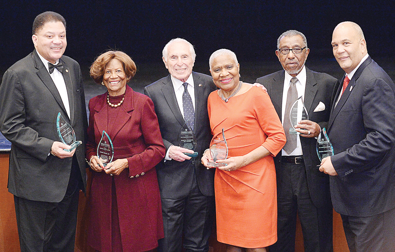 The members of the TouroCOM-Harlem Community Advisory Board (CAB), here with Dean Diamond, were honored.