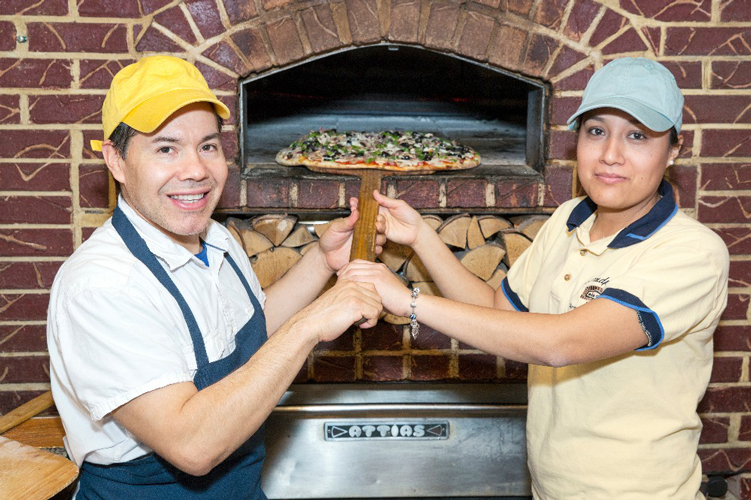 Ángel and his wife Cristina Salazar at their beloved Grandpa's Pizza.