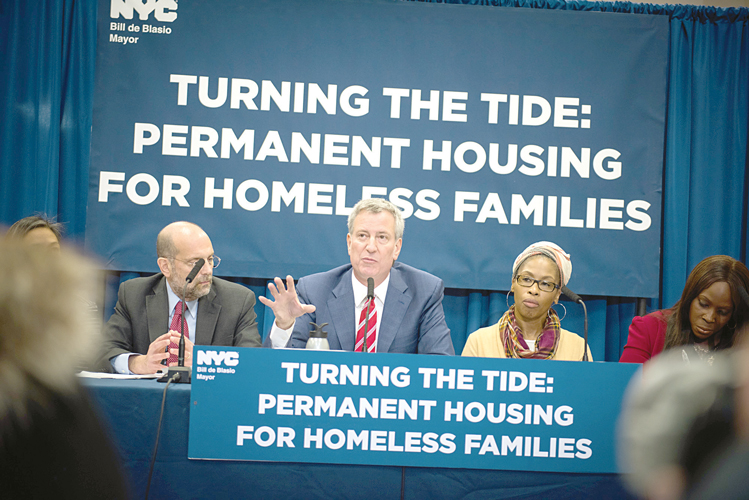 """[This] is a clear sign that we will go to any length necessary to help our neighbors,"" said Mayor Bill de Blasio (center)."