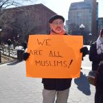 The rally marked the one-year anniversary of the travel ban.