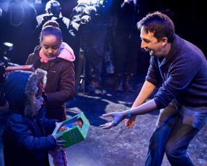 Lin-Manuel Miranda distributed gifts onstage.