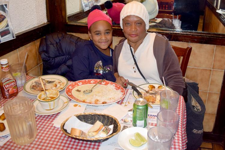 """The food was really good,"" said Azariah Joseph (left) with Brenda Adams."