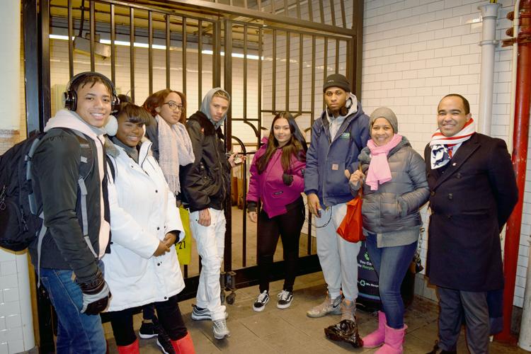 The students convene near the gates they hope MTA will unlock.