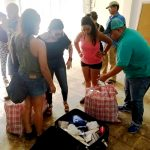 Isabel Gandía (foreground, with denim shorts) delivering Eco Kits in Mayagüez in the third week after Hurricane María.