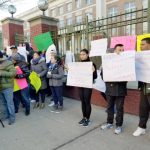 Protests were held outside the school.