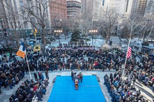 The crowd gathered at City Hall.