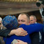 Johnson embraces Councilmember Inez Barron, who cast the lone 'no' vote.