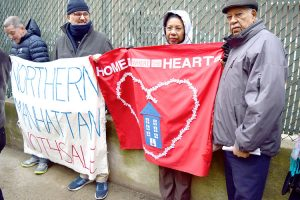 """""""Something can be built here,"""" said RENA President Josie Ventura (center, with red banner)."""