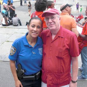 Frank Hess with 34th Precinct Community Affairs Officer Haydee Pabey.