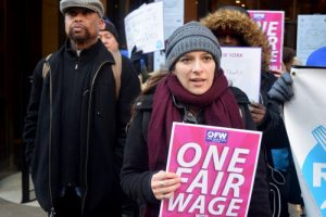 """We need one fair wage,"" said worker Marisa."