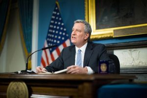 """We're coming to the table with real resources,"" said Mayor Bill de Blasio."