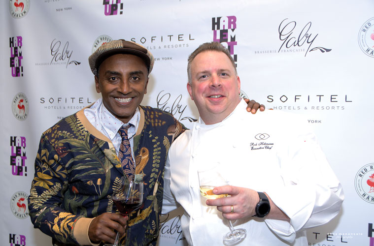 Marcus Samuelsson, of Red Rooster, and Robert Hohmann, of Gaby Brasserie Française, lift their glasses.