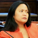 Human Rights Commissioner Carmelyn Malalis (center) testified.