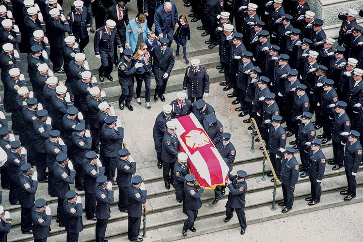 Pallbearers tend to the casket.