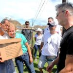 Loíza Mayor Julia Nazario (in green shirt) with residents and Ricky Martin.