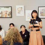 Artist Deler speaks at the artists' reception.