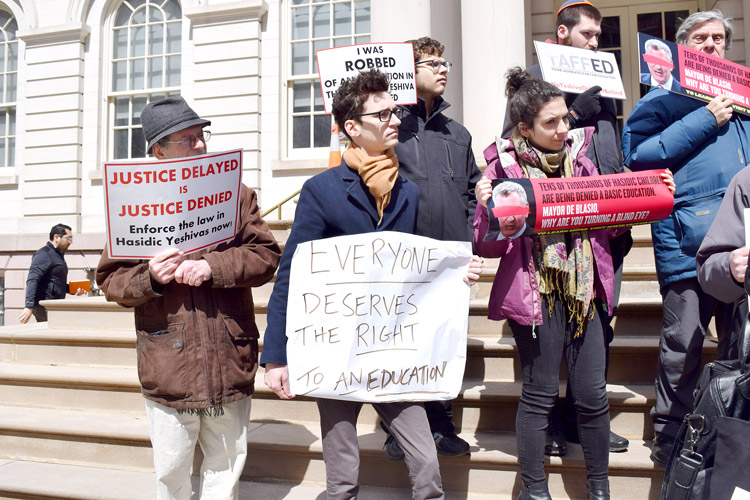 The protestors gathered at City Hall.