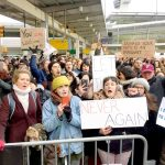 Nixon (far left) protesting at the JFK Airport; the image was shared by MRA after its endorsement.