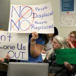 Protestors at a community meeting.