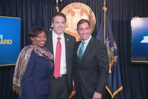 From left to right: State Senator Andrea Stewart-Cousins; Governor Andrew Cuomo; and State Senator Jeff Klein.