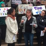 The author speaks out at City Hall.