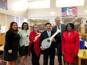 Carranza has conducted numerous school visits; here he received a laser printed guitar in Queens.