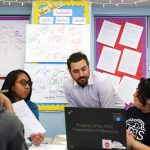 """""""Students pursue the issues that matter most to them,"""" said teacher Anthony Voulgarides (center, with students). Photo: Keith Lau"""