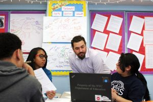 """Students pursue the issues that matter most to them,"" said teacher Anthony Voulgarides (center, with students). Photo: Keith Lau"