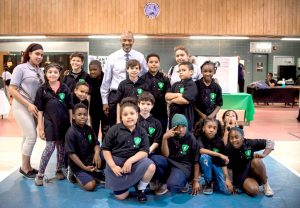 PAL Executive Director Frederick Watts meets with PAL children and staff from the Harlem Center.