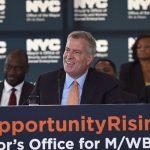 """We are reaching historic highs,"" said Mayor Bill de Blasio (center)."