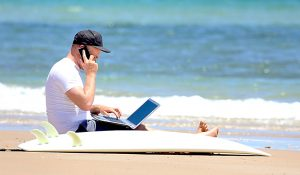 More than half of workers say they'll maintain contact with work on vacation.