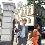 Councilmember Ydanis Rodríguez departs from City Hall after the August 8 vote.