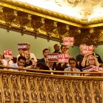 Protestors seated at the balcony of the Council's main chambers.