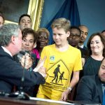 A young advocate attends the bill signing ceremony.