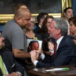 Raul Ampuero shares a moment with Mayor de Blasio. A hit-and-run driver killed Ampuero's 9-year-old son Giovanni this spring.