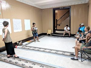 Residents take part in an organizing session against their landlord.