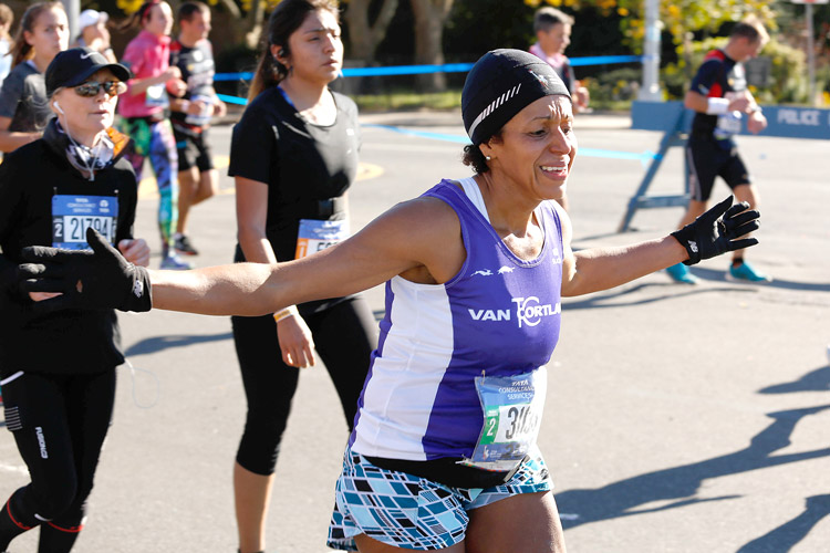 """I just want to be happy,"" said Heidy Pabón, shown here crossing the marathon finish line. Photo: Rick Bloomer 