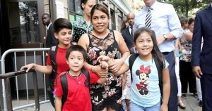Yeni González García is reunited with her children last year.