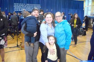 The Colindres family, including Michaela (with yellow blouse), who has been enrolled in dual language programs at P.S. 128.