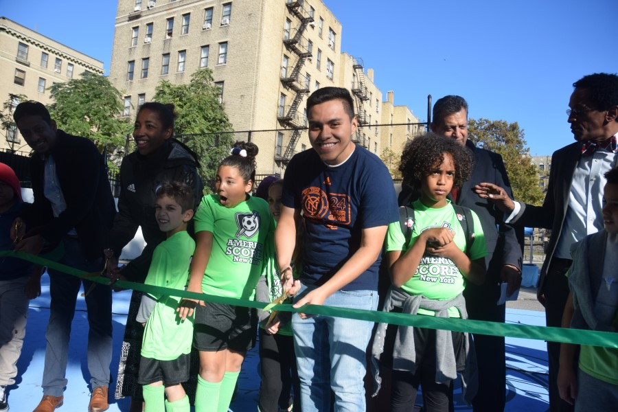 Diego Quintuna helps cut the ribbon.