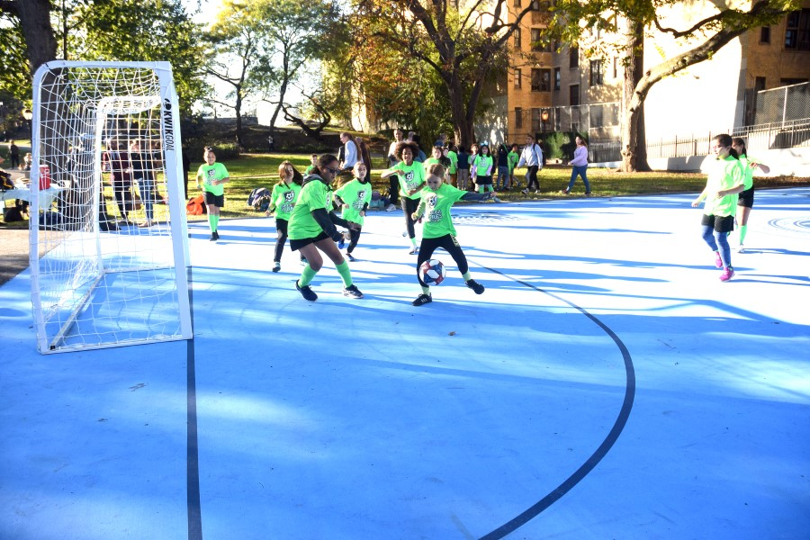 Kids held a pickup game on the new pitch in J. Hood Wright Park.